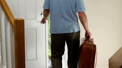 man-with-a-suitcase-leaving-the-home